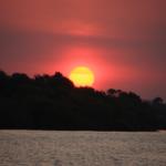 ...the sun setting at Victoria Falls.